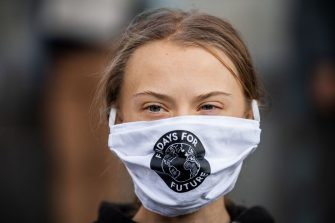 Swedish climate activist Greta Thunberg (C) takes part in a Fridays For Future protest in front of the Swedish Parliament (Riksdagen) in Stockholm on September 25, 2020. - Fridays for Future school strike movement called for a global day of climate action on September 25, 2020. (Photo by JONATHAN NACKSTRAND / AFP) (Photo by JONATHAN NACKSTRAND/AFP via Getty Images)