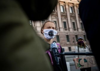 Swedish climate activist Greta Thunberg is interviewed during a Fridays For Future protest in front of the Swedish Parliament (Riksdagen) in Stockholm on September 25, 2020. - Fridays for Future school strike movement called for a global day of climate action on September 25, 2020. (Photo by JONATHAN NACKSTRAND / AFP) (Photo by JONATHAN NACKSTRAND/AFP via Getty Images)