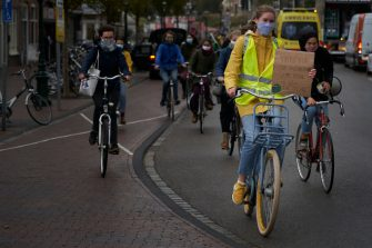 LEIDEN, NETHERLANDS. SEPTEMBER 25: Several demonstrators carry banners against climate change on their bikes during the global day of climate action on September 25, 2020 in Leiden, Netherlands. Members of the organization Fridays for Future have marched with their bikes in several Dutch cities, as a protest against the lack of policies to mitigate climate change, during the global day of climate action
