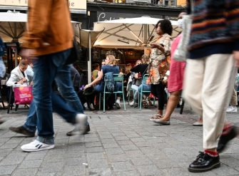 People sit at a cafe's terrace on September 9, 2020 in Lille, northern France. - From this Monday evening and for a fortnight, restaurants, night grocery stores, and bars will close at 12:30 a.m. every day in Lille to prevent the spread of the covid-19 pandemic caused  by the novel coronavirus. (Photo by DENIS CHARLET / AFP) (Photo by DENIS CHARLET/AFP via Getty Images)
