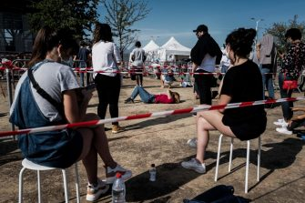 TOPSHOT - People queue to get tested for Covid-19, on September 11, 2020 in Venissieux, near Lyon, amid the novel coronavirus pandemic. (Photo by JEFF PACHOUD / AFP) (Photo by JEFF PACHOUD/AFP via Getty Images)