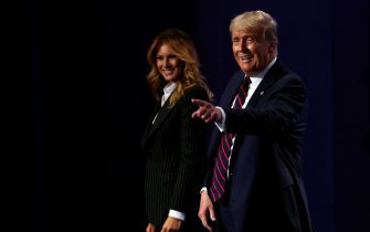 CLEVELAND, OHIO - SEPTEMBER 29:  U.S. President Donald Trump and first lady Melania Trump on stage after the first presidential debate between Trump and Democratic presidential nominee Joe Biden at the Health Education Campus of Case Western Reserve University on September 29, 2020 in Cleveland, Ohio. This is the first of three planned debates between the two candidates in the lead up to the election on November 3. (Photo by Win McNamee/Getty Images)