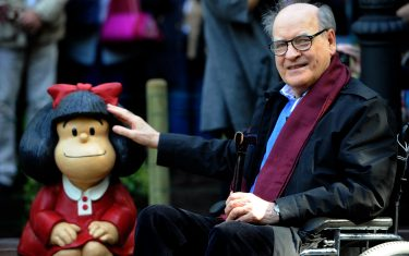Cartoonist Joaquin Salvador Lavado, aka Quino, poses beside a sculpture of his creature Mafalda at the San Francisco park in Oviedo on October 23, 2014  on the eve of the Prince of Asturias awards ceremony. Quino has been awarded the 2014 Prince of Asturias Award for Communication and Humanities. AFP PHOTO/ MIGUEL RIOPA (Photo by Miguel RIOPA / AFP) (Photo by MIGUEL RIOPA/AFP via Getty Images)