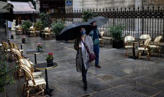 epa08697373 A couple of pedestrians wearing protective face masks walk past a deserted bistrot terrace at lunch time, in the latin quarter in central Paris, France, 25 September 2020. Cases  of coronavirus SARS-CoV-2 which causes the Covid-19 disease have surged to over 16,000 new cases recorded in a 24 hour period in France. The French government has announced new measures to be implemented in zones of active circulation for the virus, dubbed Ôred zonesÕ. The measures include limiting gatherings to 10 people or less, and imposing a 10pm curfew on bars and restaurants - an initiative which is facing push-back from restaurant and bar owners who claim their livelihoods are already at stake following the total lockdown earlier in the year.  EPA/IAN LANGSDON