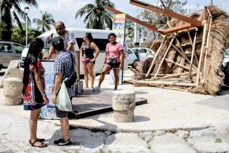 CANCUN, MEXICO - OCTOBER 8: A tours seller works without his traditional palapa kiosk due to the destruction left by Hurricane Delta on October 8, 2020 in Cancun, Mexico. Hurricane Delta made landfall in the Mexican east coast in the morning of Wednesday October 07, between Cancún and Playa del Carmen, forcing evacuations in touristic areas. Governors of regions of Quintana Roo and Yucatán reported no deceases nor major damage to the infrastructure. The powerful category 2 storm is expected to increase its power as it approaches the US Gulf coast. American National Hurricane Center informed Delta will move inland by late Friday 09. (Photo by Harold Alcocer/MediosyMedia/Getty Images)
