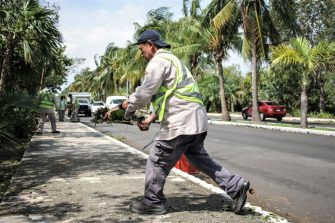 CANCUN, MEXICO - OCTOBER 8: A member of the muncipal cleaning brigade clenas on Kukulkan Boulevard, on October 8, 2020 in Cancun, Mexico. Hurricane Delta made landfall in the Mexican east coast in the morning of Wednesday October 07, between Cancún and Playa del Carmen, forcing evacuations in touristic areas. Governors of regions of Quintana Roo and Yucatán reported no deaths or major damage to the infrastructure. The powerful category 2 storm is expected to increase its power as it approaches the US Gulf coast. American National Hurricane Center informed Delta will move inland by late Friday 09. (Photo by Harold Alcocer/MediosyMedia/Getty Images)