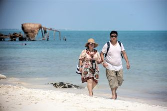CANCUN, MEXICO - OCTOBER 08: A couple walks on the beach a day after Hurricane Delta struck near Cancun on October 8, 2020 in Cancun, Mexico. Hurricane Delta made landfall in the Mexican east coast in the morning of Wednesday October 07, between Cancún and Playa del Carmen, forcing evacuations in touristic areas. Governors of regions of Quintana Roo and Yucatán reported no deceases nor major damage to the infrastructure. The powerful category 2 storm is expected to increase its power as it approaches the US Gulf coast. American National Hurricane Center informed Delta will move inland by late Friday 09.