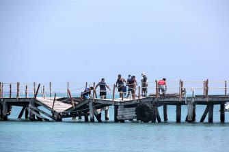 CANCUN, MEXICO - OCTOBER 8: Municipality workers repair the pier destroyed by Hurricane Delta in 'Playa Tortuga' on October 8, 2020 in Cancun, Mexico. Hurricane Delta made landfall in the Mexican east coast in the morning of Wednesday October 07, between Cancún and Playa del Carmen, forcing evacuations in touristic areas. Governors of regions of Quintana Roo and Yucatán reported no deaths or major damage to the infrastructure. The powerful category 2 storm is expected to increase its power as it approaches the US Gulf coast. American National Hurricane Center informed Delta will move inland by late Friday 09. (Photo by Harold Alcocer/MediosyMedia/Getty Images)