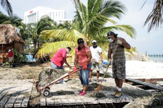 CANCUN, MEXICO - OCTOBER 8: Volunteers clean debris from Hurricane Delta in 'Playa Tortuga' on October 8, 2020 in Cancun, Mexico. Hurricane Delta made landfall in the Mexican east coast in the morning of Wednesday October 07, between Cancún and Playa del Carmen, forcing evacuations in touristic areas. Governors of regions of Quintana Roo and Yucatán reported no deaths or major damage to the infrastructure. The powerful category 2 storm is expected to increase its power as it approaches the US Gulf coast. American National Hurricane Center informed Delta will move inland by late Friday 09. (Photo by Harold Alcocer/MediosyMedia/Getty Images)