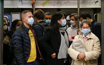 PARIS, FRANCE - OCTOBER 07: Passengers wearing protective face masks are seen in a subway train at Concorde metro station during the coronavirus outbreak (COVID 19) on October 07, 2020 in Paris, France. Since the end of confinement, due to the coronavirus, public transport attendance in Paris has fallen by 40%. A trend that seems to be lasting and Parisians who have now taken up new habits. The epidemic marks a new breakthrough in France with 18,746 new cases and 80 deaths in 24 hours. 40% of resuscitation beds are occupied by Covid-19 patients in Ile-de-France. (Photo by Chesnot/Getty Images)