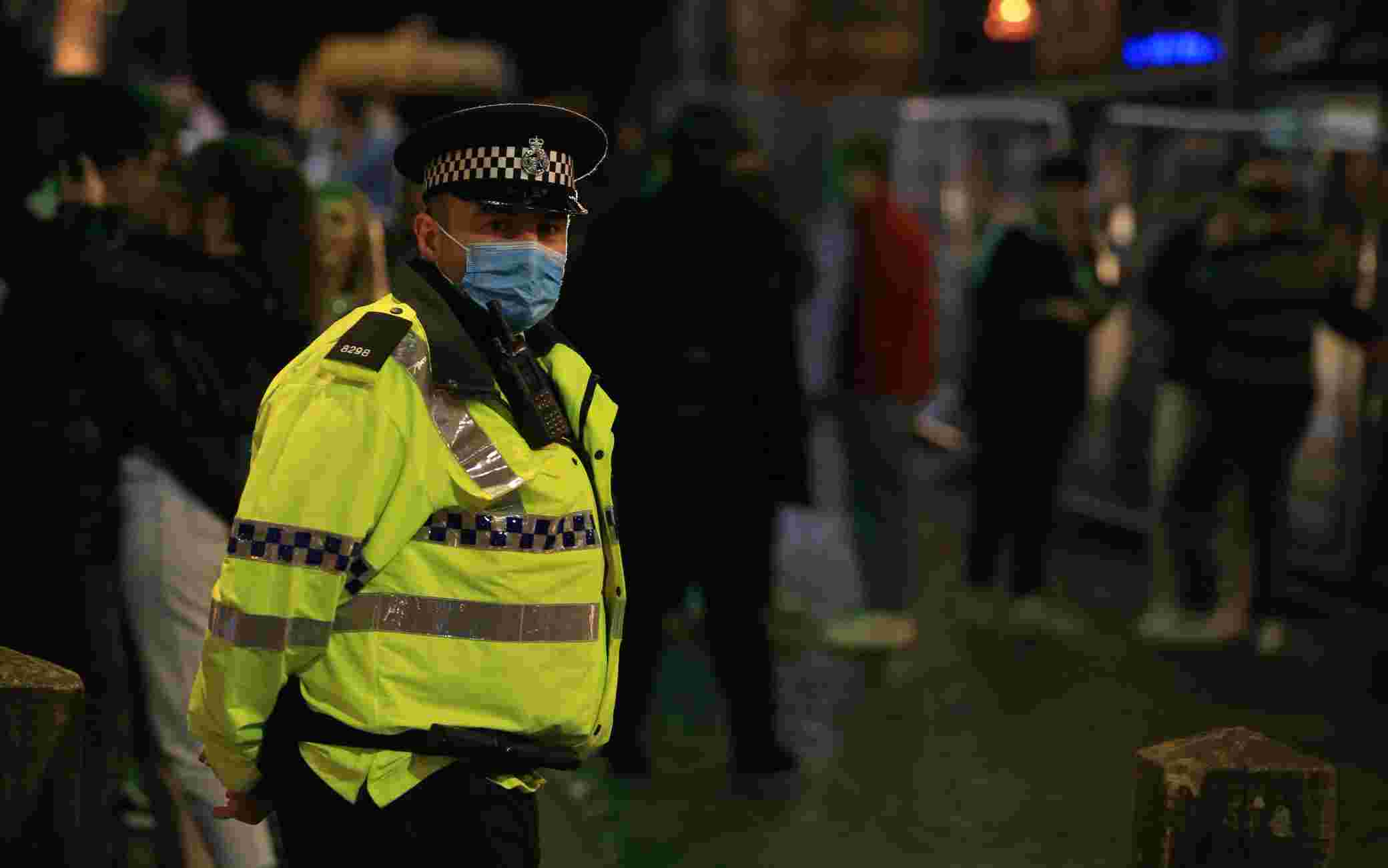 Police patrol as revellers enjoy a night out in the centre of Liverpool, north west England on October 10, 2020 ahead of new measures set to be introduced in the northwest next week to help stem the spread of the novel coronavirus. - Prime Minister Boris Johnson is expected to outline the new regime on Monday as rates of Covid 19 infection surge particularly in the north, worsening a national death toll of more than 42,000 which is already the worst in Europe. (Photo by Lindsey Parnaby / AFP) (Photo by LINDSEY PARNABY/AFP via Getty Images)