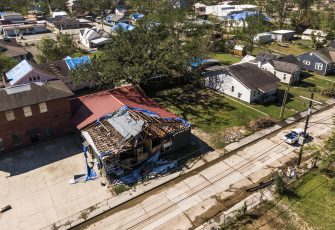 epa08734823 A photo made with a drone show a damaged building in Lake Charles, Louisiana, USA, 10 October 2020. Hurricane Delta came ashore nearby causing widespread damage and power outages to hundreds of thousands of people in Louisiana, Texas and Mississippi just six weeks after Hurricane Laura caused wiidespread damage.  EPA/TANNEN MAURY