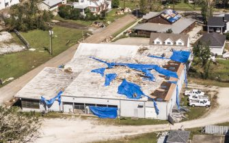 epa08734847 A photo made with a drone shows the damaged roof of a business in Lake Charles, Louisiana, USA, 10 October 2020. Hurricane Delta came ashore nearby causing widespread damage and power outages to hundreds of thousands of people in Louisiana, Texas and Mississippi just six weeks after Hurricane Laura caused wiidespread damage.  EPA/TANNEN MAURY