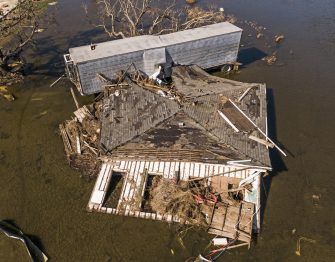 epa08735063 A photo made with a drone shows damaged property in Cameron, Louisiana, USA, 10 October 2020. Hurricane Delta came ashore nearby causing widespread damage and power outages to hundreds of thousands of people in Louisiana, Texas and Mississippi just six weeks after Hurricane Laura caused wiidespread damage.  EPA/TANNEN MAURY