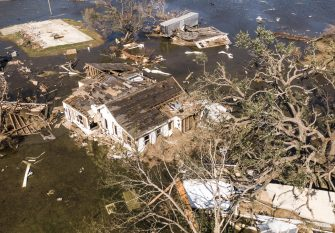 epa08735057 A photo made with a drone shows damaged property in Cameron, Louisiana, USA, 10 October 2020. Hurricane Delta came ashore nearby causing widespread damage and power outages to hundreds of thousands of people in Louisiana, Texas and Mississippi just six weeks after Hurricane Laura caused wiidespread damage.  EPA/TANNEN MAURY