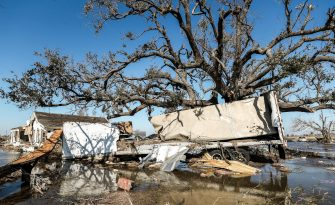 epa08735045 A destroyed trailer sits in floodwaters in Cameron, Louisiana, USA, 10 October 2020. Hurricane Delta came ashore nearby causing widespread damage and power outages to hundreds of thousands of people in Louisiana, Texas and Mississippi just six weeks after Hurricane Laura caused wiidespread damage.  EPA/TANNEN MAURY