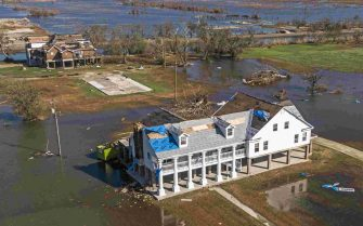 epa08735061 A photo made with a drone shows damaged property in Cameron, Louisiana, USA, 10 October 2020. Hurricane Delta came ashore nearby causing widespread damage and power outages to hundreds of thousands of people in Louisiana, Texas and Mississippi just six weeks after Hurricane Laura caused wiidespread damage.  EPA/TANNEN MAURY