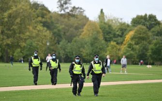 Police wear face masks as they patrol prior to a protest action against restrictions imposed during the novel coronavirus COVID-19 pandemic, in Hyde Park, central London on October 10, 2020. - British Prime Minister Boris Johnson is expected next week to outline a new three-tier lockdown system as rates of coronavirus infection surge particularly in northern England. (Photo by JUSTIN TALLIS / AFP) (Photo by JUSTIN TALLIS/AFP via Getty Images)