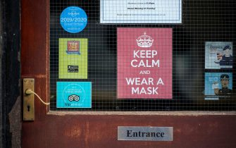 LIVERPOOL, ENGLAND - OCTOBER 08: A 'Keep Calm and Wear A Mask' sign adorns a door on October 08, 2020 in Liverpool, England. It has been reported that a three-tier lockdown system, similar to a traffic light system is being contemplated by the British government to simplify coronavirus (Covid-19) lockdown measures. (Photo by Christopher Furlong/Getty Images)