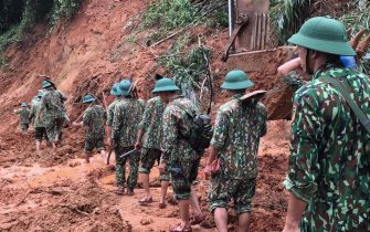 epa08754553 Rescue workers in action during an operation searching for missing people after a landslide which left at least 22 soldiers missing Quang Tri province, Vietnam, 18 October 2020.  EPA/STR VIETNAM OUT  EDITORIAL USE ONLY/NO SALES