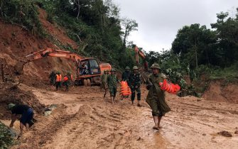 epa08754550 Rescue workers in action during an operation searching for missing people after a landslide which left at least 22 soldiers missing Quang Tri province, Vietnam, 18 October 2020.  EPA/STR VIETNAM OUT  EDITORIAL USE ONLY/NO SALES
