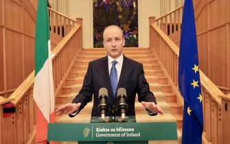 """Ireland's Prime Minister Micheal Martin addresses the Irish nation at Government Buildings in Dublin on October 19, 2020. - Ireland will be the first EU country to return to coronavirus lockdown, prime minister Micheal Martin said Monday, October 19, issuing a nationwide """"stay at home"""" order but insisting schools will stay open. (Photo by Julien BEHAL / POOL / AFP) (Photo by JULIEN BEHAL/POOL/AFP via Getty Images)"""