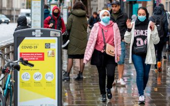 Pedestrians wearing face coverings due to the COIVD-19 pandemic, walk in Dublin on October 19, 2020, amid reports that further lockdown restrictions could be imposed to help mitigate the spread of the novel coronavirus. - Ireland will crank up coronavirus restrictions, prime minister Micheal Martin said last week, announcing a raft of new curbs along the border with the British province of Northern Ireland. (Photo by PAUL FAITH / AFP) (Photo by PAUL FAITH/AFP via Getty Images)