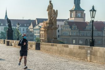 A man is seen running wearing a protective mask on Charles bridge on the first day of the end of the state of emergency. State of emergency due to the Coronavirus (Covid-19) pandemic, which was declared by the Czech government in the whole territory of the Czech Republic on 12th March has ended. 18th of May is the first day after the State of Emergency officially comes to the end for the people in Czech republic, however wearing of protective face masks on public spaces such as closed indoor restaurants and hotels remains a required by law. (Photo by Tomas Tkacik / SOPA Images/Sipa USA) (Tomas Tkacik / SOPA Images / IPA/Fotogramma, Prague - 2020-05-18) p.s. la foto e' utilizzabile nel rispetto del contesto in cui e' stata scattata, e senza intento diffamatorio del decoro delle persone rappresentate