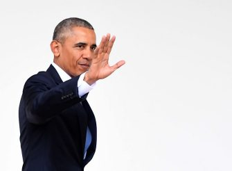 US President Barack Obama waves as he walks through the colonnade as he departs the Oval Office for the last time as president, at the White House in Washington, DC January 20, 2017.  / AFP / JIM WATSON        (Photo credit should read JIM WATSON/AFP via Getty Images)