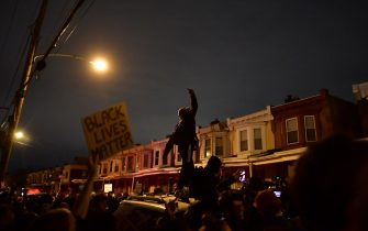 PHILADELPHIA, PA - OCTOBER 27: Demonstrators gather in protest near the location where Walter Wallace, Jr. was killed by two police officers on October 27, 2020 in Philadelphia, Pennsylvania. Protests erupted after the fatal shooting of 27-year-old Wallace Jr, who Philadelphia police officers claimed was armed with a knife. (Photo by Mark Makela/Getty Images)