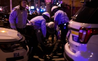 Police arrest a protester during a demonstration in West Philadelphia on October 27, 2020, against the fatal shooting of 27-year-old Walter Wallace, a Black man, by police. - Hundreds of people demonstrated in Philadelphia late on October 27, with looting and violence breaking out in a second night of unrest after the latest police shooting of a Black man in the US. The fresh unrest came a day after the death of 27-year-old Walter Wallace, whose family said he suffered mental health issues. On Monday night hundreds of demonstrators took to the streets, with riot police pushing them back with shields and batons. (Photo by GABRIELLA AUDI / AFP) (Photo by GABRIELLA AUDI/AFP via Getty Images)