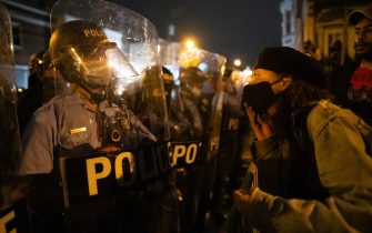 PHILADELPHIA, PA - OCTOBER 27: A demonstrator screams at police forming a barricade line during a protest near the location where Walter Wallace, Jr. was killed by two police officers on October 27, 2020 in Philadelphia, Pennsylvania. Protests erupted after the fatal shooting of 27-year-old Wallace Jr, who Philadelphia police officers claimed was armed with a knife. (Photo by Mark Makela/Getty Images)