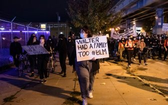 Protesters march through West Philadelphia on October 27, 2020, to protest the fatal shooting of 27-year-old Walter Wallace, a Black man, by police. - Hundreds of people demonstrated in Philadelphia late on October 27, with looting and violence breaking out in a second night of unrest after the latest police shooting of a Black man in the US. The fresh unrest came a day after the death of 27-year-old Walter Wallace, whose family said he suffered mental health issues. On Monday night hundreds of demonstrators took to the streets, with riot police pushing them back with shields and batons. (Photo by GABRIELLA AUDI / AFP) (Photo by GABRIELLA AUDI/AFP via Getty Images)