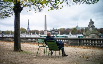 epa08785685 A man takes a break at Tuileries garden as parks remain open during the lockdown, in Paris, France, 30 October 2020. French President Emmanuel Macron announced in a televised statement that France will 'reconfine' and lockdown for a minimum of four weeks to battle the rise in Covid-19 cases as France is facing a second wave of the COVID-19 coronavirus pandemic.  EPA/YOAN VALAT