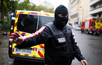 French police forces wearing hood gather at the scene of an attack in which several people were injured near the former offices of the French satirical magazine Charlie Hebdo by a man wielding a knife in the capital Paris on September 25, 2020. A man armed with a knife seriously wounded two people on September 25, 2020, in a suspected terror attack outside the former offices of French satirical weekly Charlie Hebdo in Paris, three weeks into the trial of men accused of being accomplices in the 2015 massacre of the newspaper's staff. Charlie Hebdo had angered many Muslims around the world by publishing cartoons of the Prophet Mohammed, and in a defiant gesture ahead of the trial this month, it reprinted the caricatures on its front cover. Photo by Raphael Lafargue/ABACAPRESS.COM