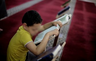 Palestinian kid seen reading the Koran at the mosque of light during Ramadan. With the support of Islamic Jihad, approximately 10,000 children, boys and girls will memorise the Koran for 60 days. Third day of Ramadan. Muslims throughout the world are participating in the holy fasting month of Ramadan, the holiest month in Islamic calendar, refraining from eating, drinking and smoking from dawn to dusk. (Photo by Mahmoud Issa / SOPA Images/Sipa USA)