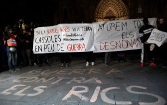 "A text reads on the pavement ""War against the rich"" during a demonstration against evictions amid the COVID-19 pandemic in Barcelona on October 31, 2020. - Protesters clashed with police in central Barcelona yesterday after hundreds gathered to demonstrate against new coronavirus restrictions, including a curfew and a ban on leaving the city over the holiday weekend. (Photo by Josep LAGO / AFP) (Photo by JOSEP LAGO/AFP via Getty Images)"