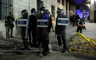 Catalan anti-riot police officers stand guard during a demonstration against evictions amid the COVID-19 pandemic in Barcelona on October 31, 2020. - Protesters clashed with police in central Barcelona yesterday after hundreds gathered to demonstrate against new coronavirus restrictions, including a curfew and a ban on leaving the city over the holiday weekend. (Photo by Josep LAGO / AFP) (Photo by JOSEP LAGO/AFP via Getty Images)