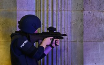 "An armed policeman guards the passage of the state opera in central Vienna on November 2, 2020, following a shooting near a synagogue. - Multiple gunshots were fired in central Vienna on Monday evening, according to police, with the location of the incident close to a major synagogue. Police urged residents to keep away from all public places or public transport. One attacker was ""dead"" and another ""on the run"", with one police officer being seriously injured, Austria's interior ministry said according to news agency APA. (Photo by Joe Klamar / AFP) (Photo by JOE KLAMAR/AFP via Getty Images)"