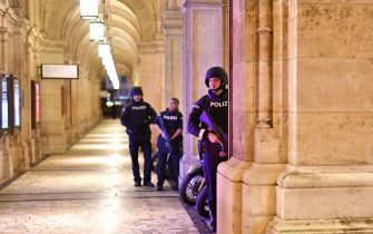 "Armed police control a passage near the opera in central Vienna on November 2, 2020, following a shooting near a synagogue. - Multiple gunshots were fired in central Vienna on Monday evening, according to police, with the location of the incident close to a major synagogue. Police urged residents to keep away from all public places or public transport. One attacker was ""dead"" and another ""on the run"", with one police officer being seriously injured, Austria's interior ministry said according to news agency APA. (Photo by JOE KLAMAR / AFP) (Photo by JOE KLAMAR/AFP via Getty Images)"
