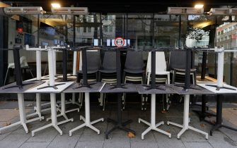 epa08788040 Locked chairs stand in front of a restaurant at the shopping street Zeil in Frankfurt am Main, Germany, 31 October 2020. The State of Hesse's authorities imposed tightened coronavirus restrictions, including wearing a mask in downtown, as the number of coronavirus cases all over in the country has exceeded the level of 50 new infections per 100,000 residents.  EPA/RONALD WITTEK