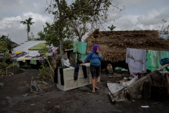 GUINOBATAN, PHILIPPINES - NOVEMBER 2: A resident stands in front of her damaged house in the aftermath of Super Typhoon Goni on November 2, 2020 in Guinobatan, Philippines. Super Typhoon Goni, this year's most powerful storm in the world, hit the Philippines with wind gusts of up to 165 miles per hour on November 1. The typhoon left at least ten people killed. (Photo by Jes Aznar/Getty Images)