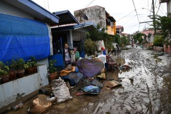 Residents clean their homes following flooding in Batangas City on November 2, 2020, after super Typhoon Goni made landfall in the Philippines on November 1. (Photo by TED ALJIBE / AFP) (Photo by TED ALJIBE/AFP via Getty Images)