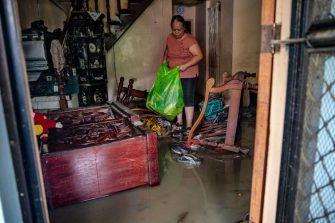 BATANGAS, PHILIPPINES - NOVEMBER 02: A resident cleans her house filled with mud left behind by flashfloods caused by Typhoon Goni on November 2, 2020 in Batangas city, south of Manila, Philippines. Super Typhoon Goni, this year's most powerful storm in the world, hit the Philippines with wind gusts of up to 165 miles per hour on November 1. The typhoon left at least ten people killed. (Photo by Ezra Acayan/Getty Images)