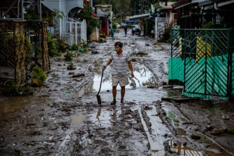 BATANGAS, PHILIPPINES - NOVEMBER 02: A man shovels mud out of his house left behind by flashfloods caused by Typhoon Goni on November 2, 2020 in Batangas city, south of Manila, Philippines. Super Typhoon Goni, this year's most powerful storm in the world, hit the Philippines with wind gusts of up to 165 miles per hour on November 1. The typhoon left at least ten people killed. (Photo by Ezra Acayan/Getty Images)