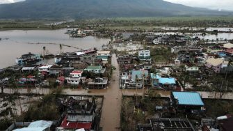 An aerial view shows destroyed and flooded houses after super Typhoon Goni hit the town of Malinao, Albay province, south of Manila on November 1, 2020. (Photo by Charism SAYAT / AFP) (Photo by CHARISM SAYAT/AFP via Getty Images)