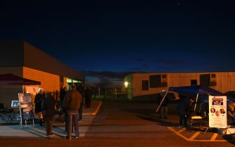 """Voters wait in line at a polling station on US Election Day in Winchester, Virginia early November 3, 2020. - Polling stations opened in New York, New Jersey and Virginia early November 3, marking the start of US Election Day as President Donald Trump seeks to beat forecasts and defeat challenger Joe Biden. The vote is widely seen as a referendum on Trump and his uniquely brash, bruising presidency that Biden urged Americans to end to restore """"our democracy."""" (Photo by ANDREW CABALLERO-REYNOLDS / AFP) (Photo by ANDREW CABALLERO-REYNOLDS/AFP via Getty Images)"""