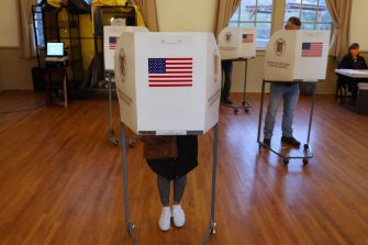 epa08795127 Voters stand at voting booths before casting paper ballots at a polling location at the Old Stone School in Hillsboro, Virginia, USA, 03 November 2020. Americans vote on Election Day to choose between re-electing Donald J. Trump or electing Joe Biden as the 46th President of the United States to serve from 2021 through 2024.  EPA/MICHAEL REYNOLDS