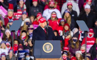 epa08794596 US President Donald J. Trump speaks during his final campaign rally before Election Day, at Gerald R. Ford International Airport, in Grand Rapids, Michigan, USA, 02 November 2020. Trump will face Democratic candidate and former Vice President Joe Biden in the presidential election on 03 November.  EPA/JEFFREY SAUGER
