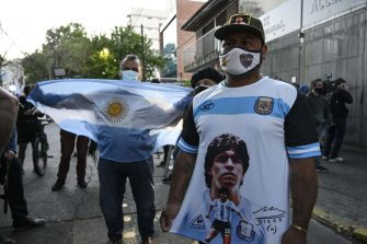 Supporters of Argentine former football star and coach of Gimnasia y Esgrima La Plata Diego Maradona gather outside the hospital where he will undergo brain surgery for a blood clot, in Olivos, Buenos Aires province, on November 3, 2020. (Photo by JUAN MABROMATA / AFP) (Photo by JUAN MABROMATA/AFP via Getty Images)